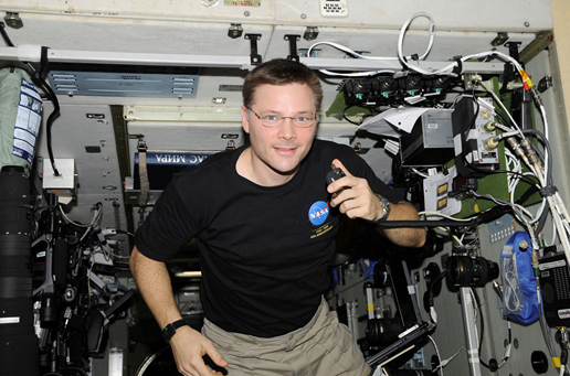 Doug Wheelock, KF5BOC, Expedition 24 flight engineer, operates the NA1SS ham radio station in the Zvezda Service Module of the International Space Station.